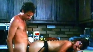 Horny brown-haired pounded in the kitchen